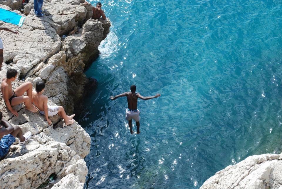 Jumping in the blue sea, by Living the dream