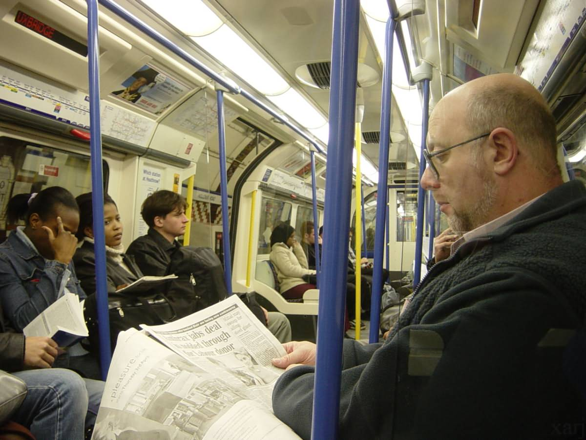 People ignoring each other on the London Underground