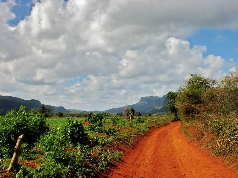 valle-de-vinales-pinar-del-rio-province-cuba-biking -path-cloudy-sky