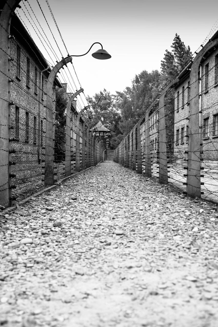 visit_Auschwitz_Birkenau_concentration_camps_holocaust_images_deserted_road_in_Auschwitz_museum_and_electric_fences