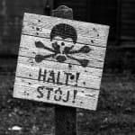 Auschwitz-dark-tourism-electric-fences-sign