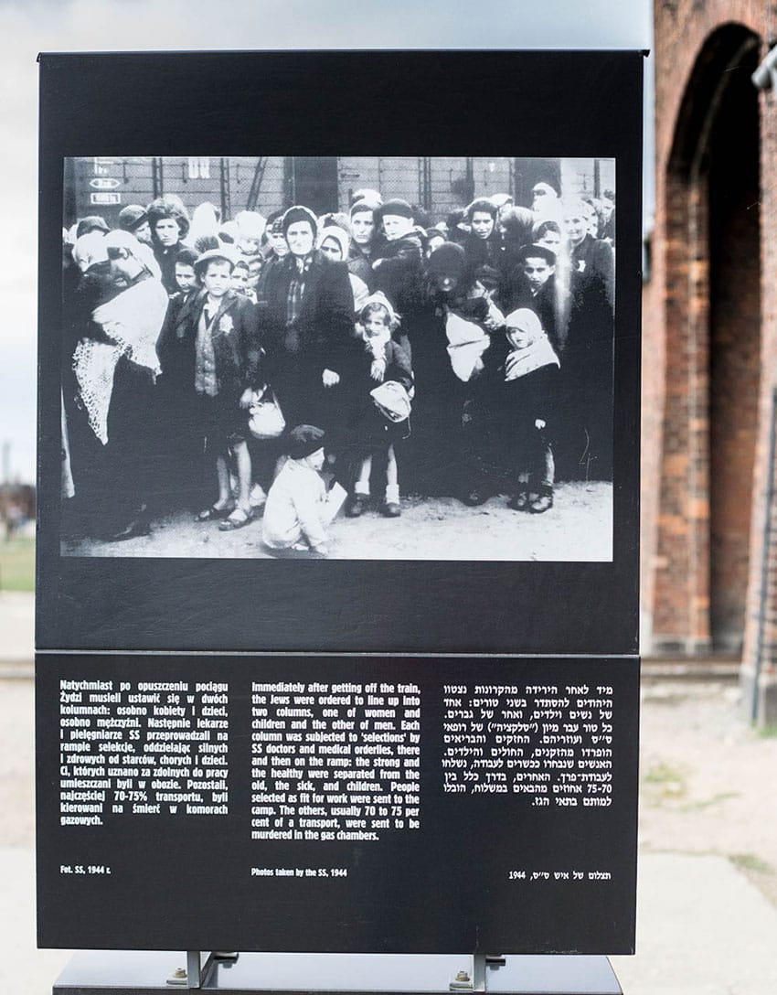 visit_Auschwitz_Birkenau_concentration_camps_holocaust_images_panel_with_the_numbers_of_the_jewish_genocide_outside_birkenau