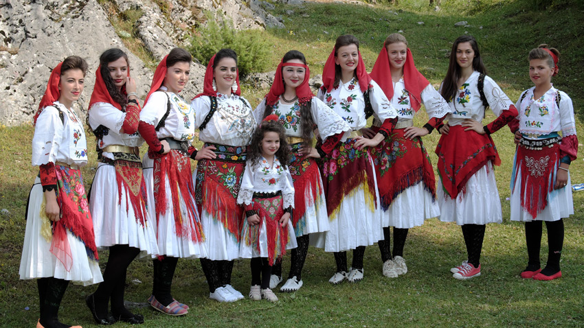 Albanian-people-in-traditional-costumes-VUSANJE-MONTENEGRO-female-components-of-albania-folk-group-dressed-with-colorful-traditional-costumes-in-Montenegro-near-the-border-with-North-Albania