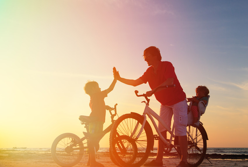 Biker-family-silhouette,-father-with-two-kids-on-bikes