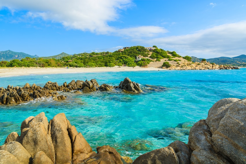 TOP-SARDINIA-BEACHES-Rocks-in-crystal-clear-sea-water-of-Villasimius-beach-Sardinia-island-Italy