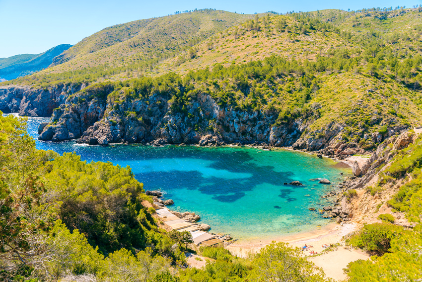 Ibiza-best-beaches-spain-balearic-islands-View-of-secluded-Cala-d'en-Serra-beach-and-coastal-cliff-rocks-Ibiza-island-Spain