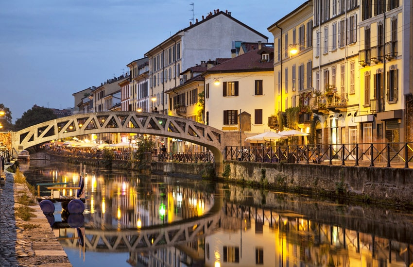 ITALY-ROAD-TRIP-MILAN-Bridge-across-the-Naviglio-Grande-canal-at-the-evening-in-Milan-Italy