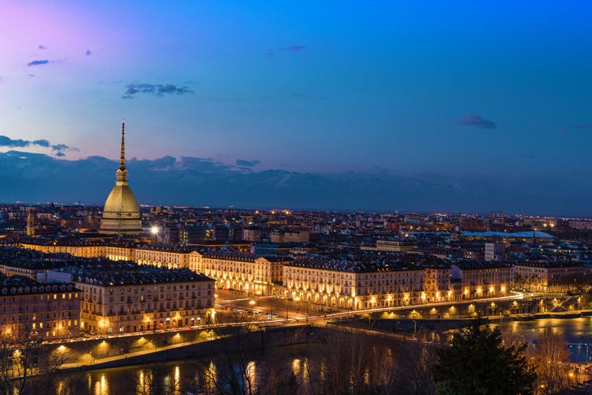 PLACES-TO-VISIT-DURING-WINTER-ITALY-ROAD-TRIP-Turin-skyline-at-dusk-Torino-Italy-panorama-cityscape-with-the-Mole-Antonelliana-over-the-city