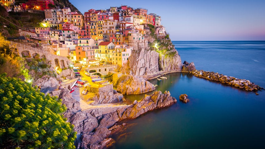 italy-road-trip-Panorama-view-of-Manarola-village-one-of-Cinque-Terre-at-night-in-La-Spezia-Italy