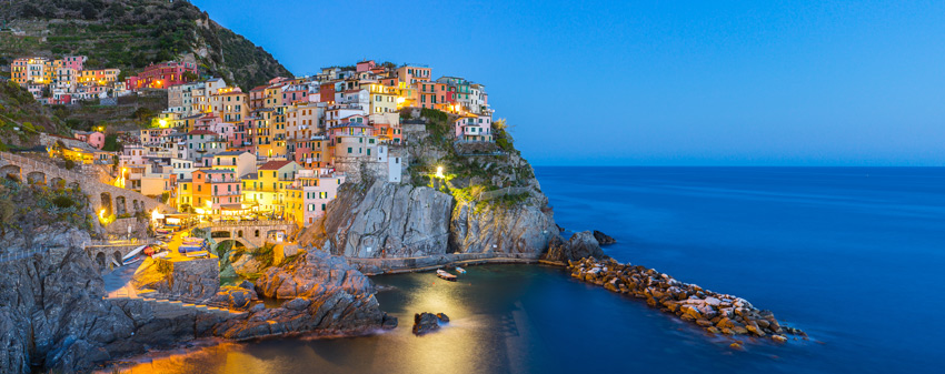 cinque-terre-day-trips-and-tours-Panorama-view-of-Manarola-village-one-of-Cinque-Terre-at-night-in-La-Spezia-Italy