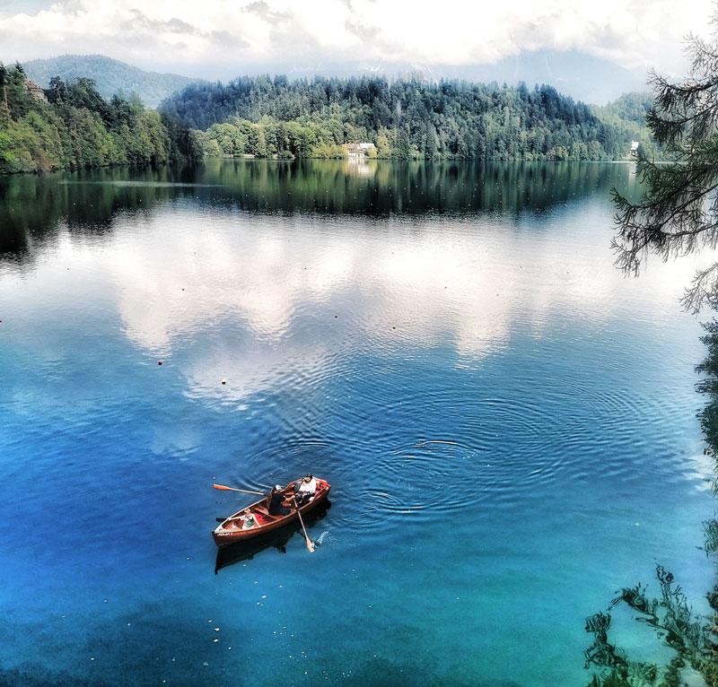 lake-bled-boat-visit-slovenia-in-one-week-by-campervan